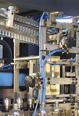 Equipo para produción de preformas y tapones