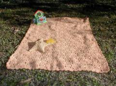 Esta mantilla está realizada en lana Guillermina