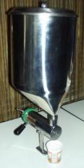 Dosificador manual para productos viscosos y